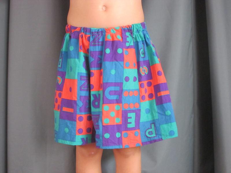 short à motif bleus orange et verts